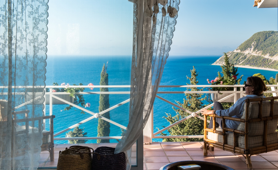 relaxin on balcony at lefkada island - sea view